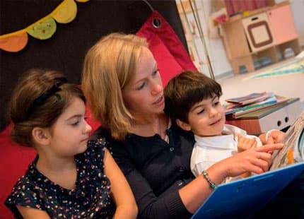 Kids enjoying being read a story